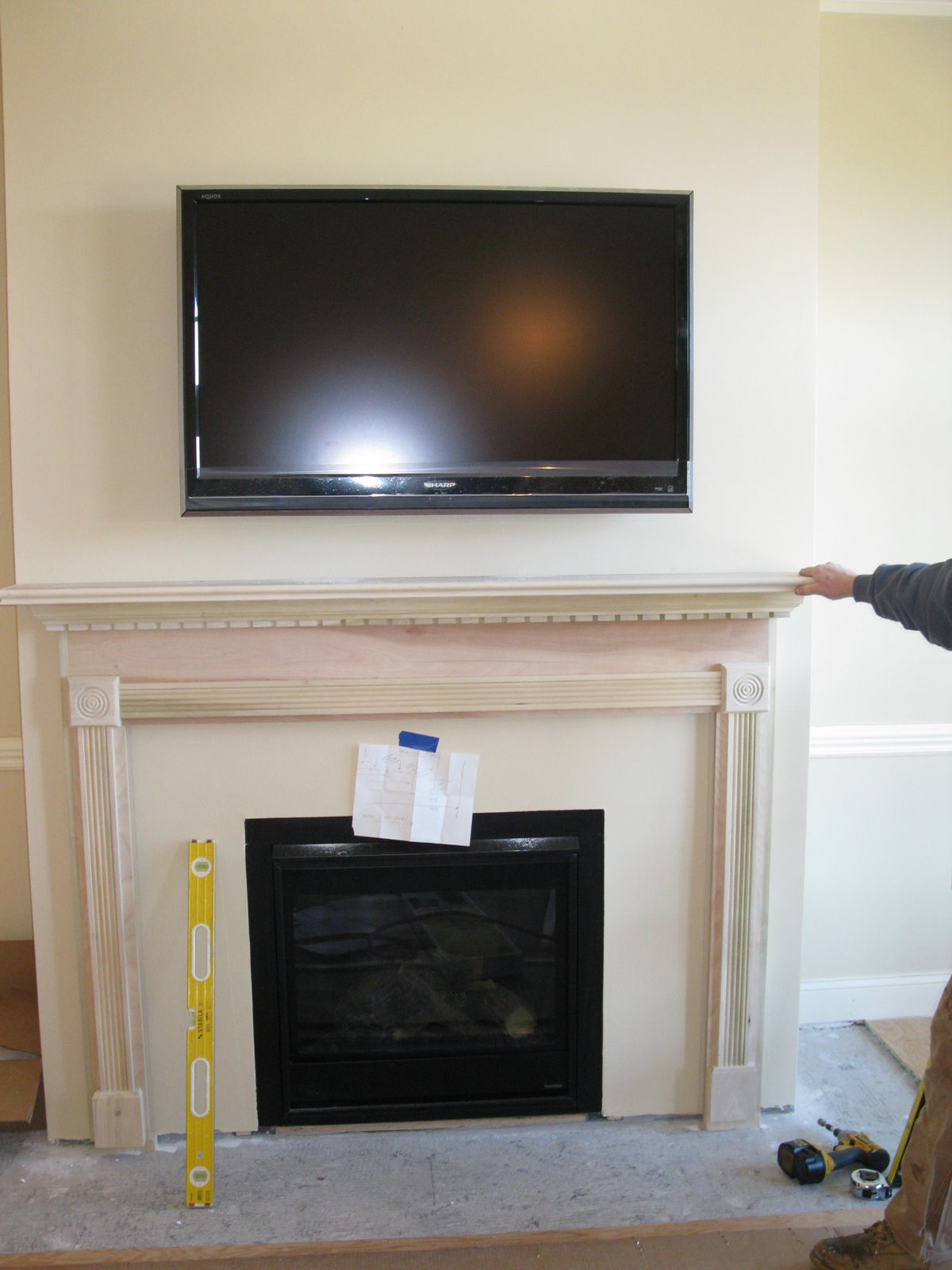 "Installing a fireplace mantle is easy if you buy a ""mantle in a box."" Learn more"