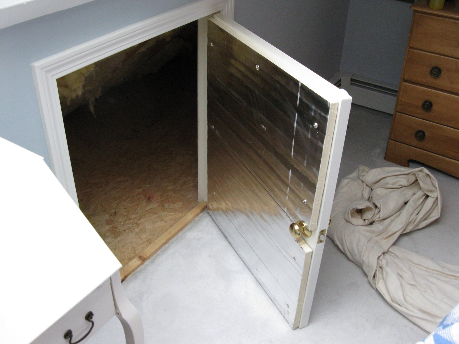 How to insulate a crawlspace door a concord carpenter for Insulated entry door