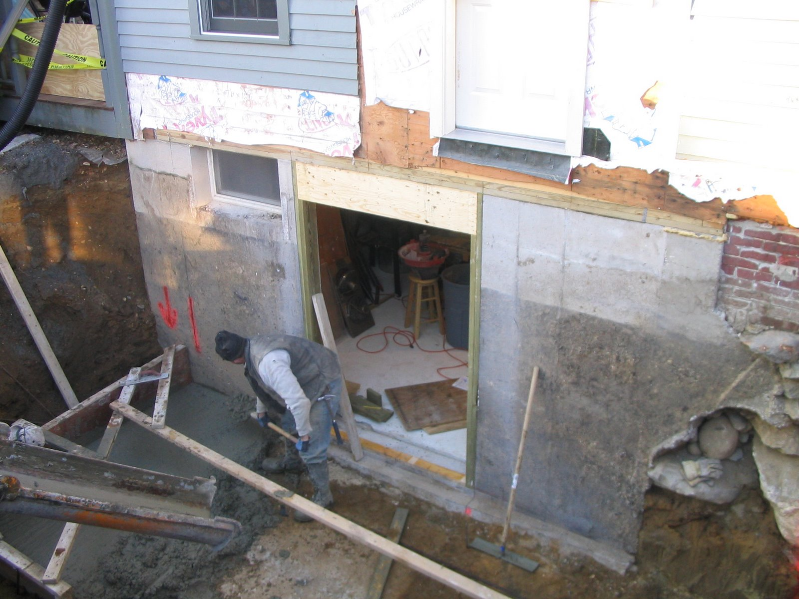Cutting a door in a concrete foundation for Does a walkout basement cost more