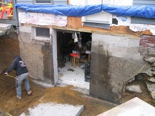 Cutting a door in a concrete foundation for Ways to cut cost when building a house