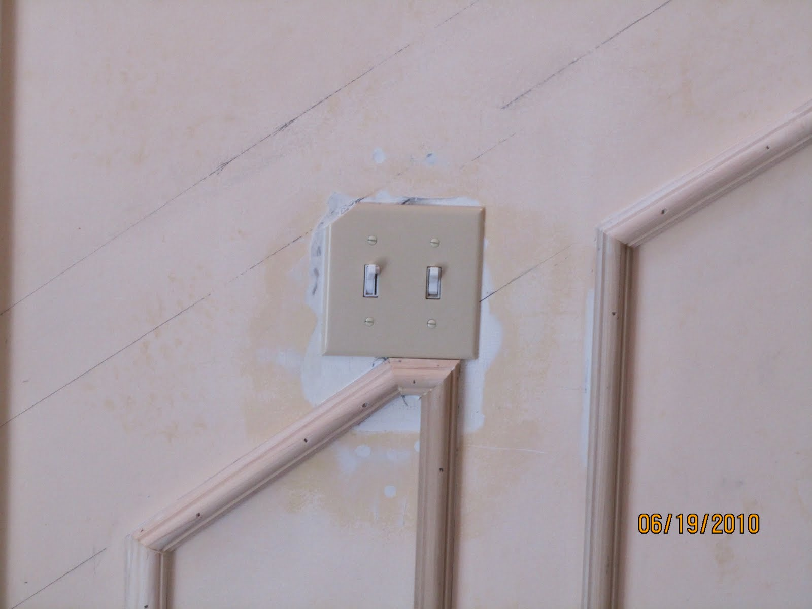 Chair Rail Light Switch Part - 16: Even After Moving The Light Switch We Still Had To Modify Our Wainscoting  Panel Slightly.